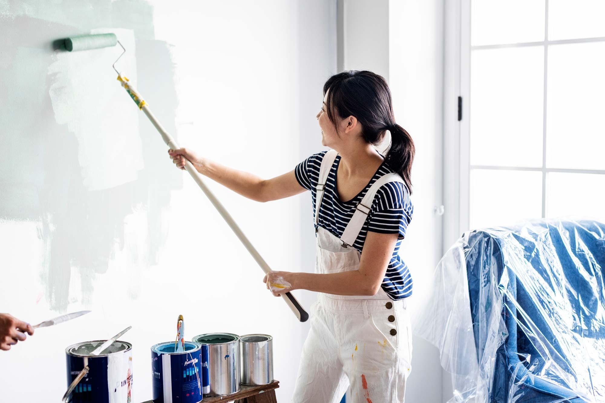 woman painting wall