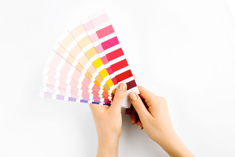 hand holding pantone colors